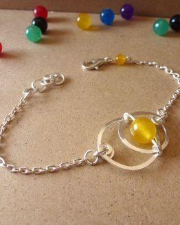 Bracelet Astro avec une perle en jade jaune fait main par Annamorfoz