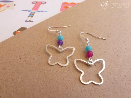 Boucles d'oreilles papillons argentés, turquoise, rose et violet faites à la main par Annamorfoz