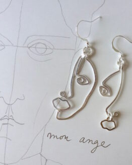 boucles d'oreilles en forme de visages fait main
